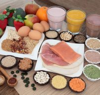46565416 - health and body building food with fish and meat, supplement powders, vitamin tablets, pulses, nuts, vegetables, fruit and high protein and juice smoothie shakes.