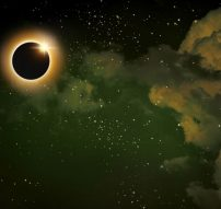 43212769 - imaginary solar eclipse space with clouds and stars.